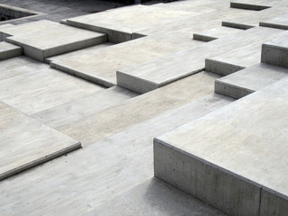 grey modern geometric cubic concrete steps forming angular patterns and shapes Wall mural