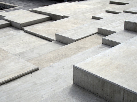 grey modern geometric cubic concrete steps forming angular patterns and shapes