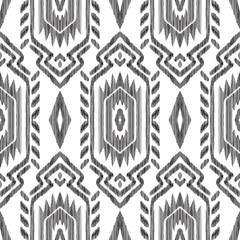 Ikat seamless background. Aztec, navajo, mexican design. Black and white tribal pattern. Can be used for textile, wallpaper, wrapping paper, greeting card backdrop, print.