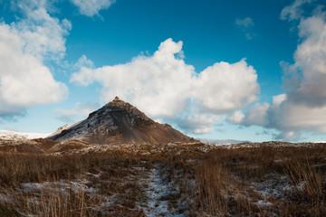 Mountain in winter field