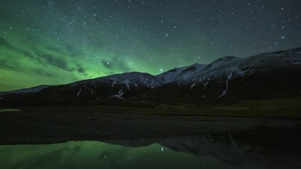 Fototapete - Aurora Borealis Over Snowy Mountains In Iceland