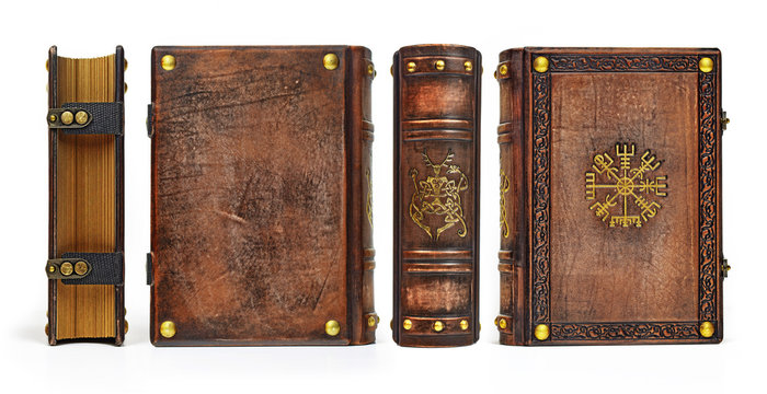 Aged leather book with gilded ancient viking symbols the Vegvisir on the front cover plate and the Cernunnos on the spine - captured in standing position from all four sides. Picture width > 10k px.