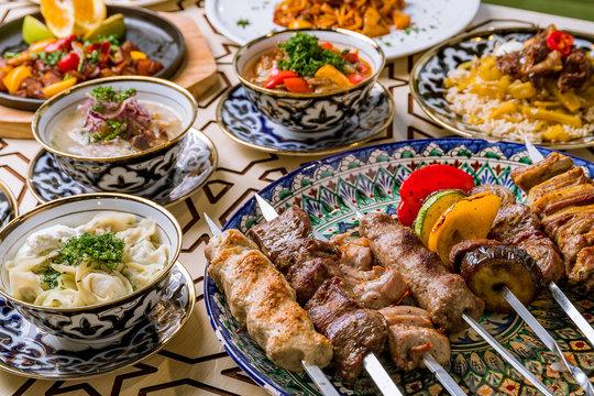 dishes of Uzbek cuisine lagman, pilaf, skewers