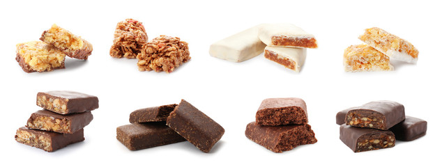 Set of different sweet protein bars on white background