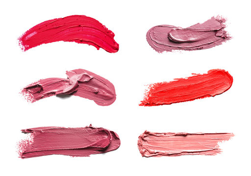 Set of different lipstick swatches on white background, top view