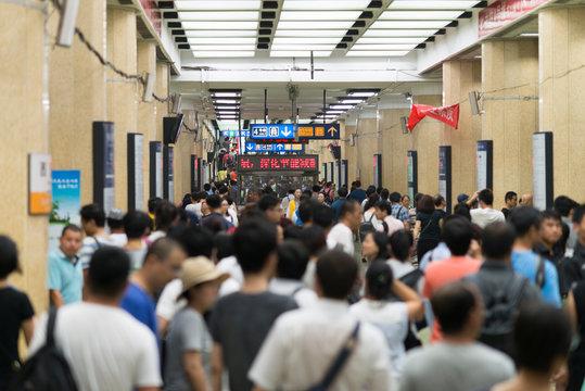 Beijing, China - 08 02 2016: Passengers crowd an underground Subway Railway Station in Beijing, China