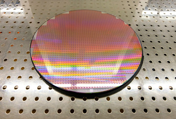 Wall Mural - Silicon wafers on table waiting for inspection, wafers Colors reflect light in a variety of colors colorful and reflection. Semiconductor
