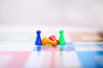Picture of colorful ludo tokens on the ludo game.