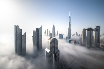 Cityscape of Dubai Downtown skyline on a foggy winter day. Dubai, UAE. Wall mural
