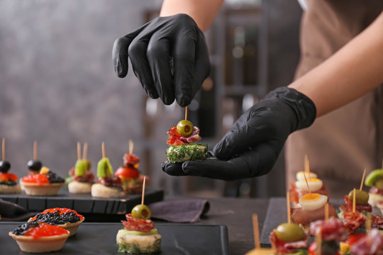 Chef preparing tasty canapes for serving