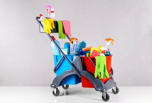 Set of cleaning supplies on light background