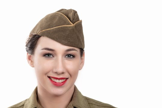 pretty young woman in ww2 uniform us with garrison cap on white