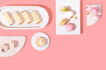 Assorted Colorful Dessert Cakes on Bright Background, Minimal and Isolated with Copy Space