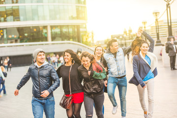 Multiracial group friends having fun in the city at sunset