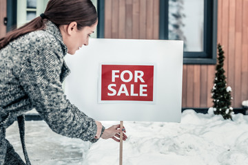 Stylish experienced real estate agent working in winter
