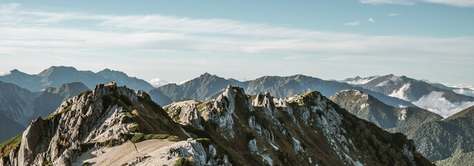 Panoramic mountain scenery landscape of Tsubakuro mountain in Northern Japan Alps in Nagano, Japan. Adventure and mountaineering activity concept. Wall mural