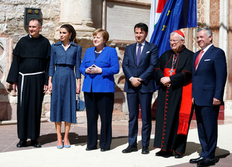 King Abdullah II of Jordan, his wife Queen Rania, German Chancellor Angela Merkel and Italian Prime Minister Giuseppe Conte pose for a picture at the Basilica of St. Francis of Assisi