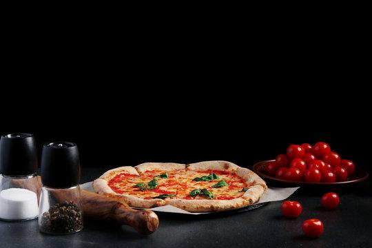 margarita pizza on dark background. traditional pizza concept