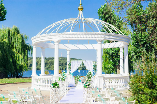 white gazebo and wedding ceremony. Lake shore