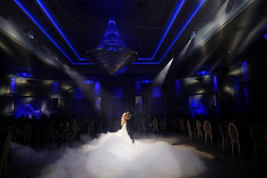 Beautiful wedding couple dancing on their wedding