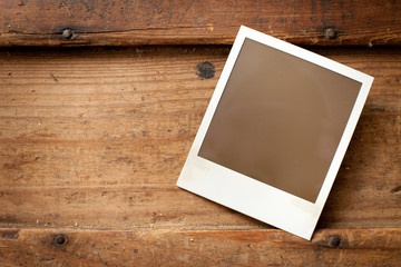 Blank Instant Film Photo on Old Wood Background