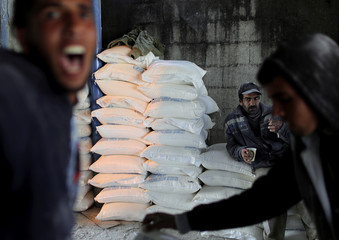 Palestinian worker rests inside a United Nations food distribution center in Al-Shati refugee camp in Gaza City