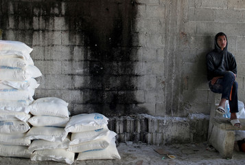 Palestinian sits inside a United Nations food distribution center in Al-Shati refugee camp in Gaza City