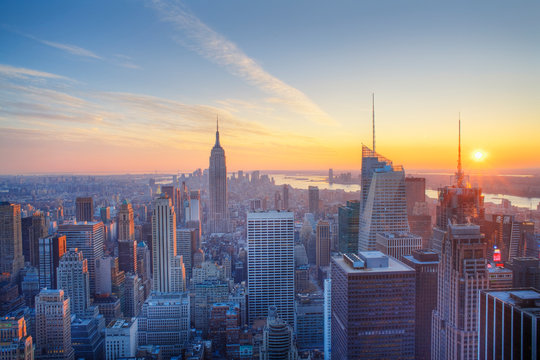 Empire State building and Manahttan skyline at sunset new york city new york usa