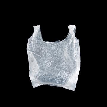White plastic bag on black background