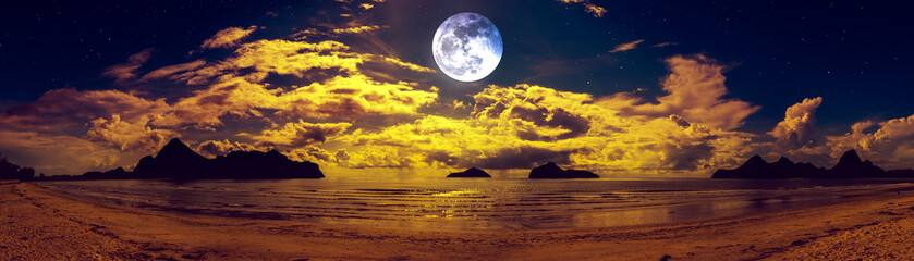 Wall Mural - Beautiful panorama view of the sea. Colorful blue sky with cloud and bright full moon on seascape to night.