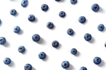 Flatlay pattern with fresh ripe blueberries isolated on white background Wall mural