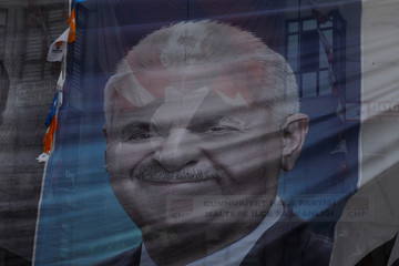 An election poster of AK Party candidate for mayor in Istanbul Binali Yildirim is seen as a portrait of the founder of the modern Turkey Mustafa Kemal Ataturk is hanged to the background a head of the local elections in Istanbul