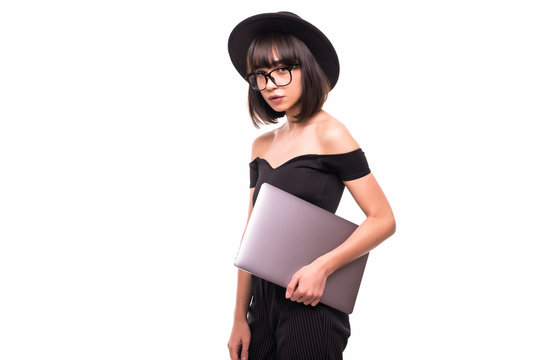 Portrait of happy woman standing with laptop isolated on white background
