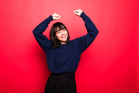 Young woman wearing casual sweater stretching back, tired and relaxed, sleepy and yawning for early morning over isolated on red background