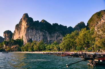 Longboats along the coastline near Railay Beach in Thailand