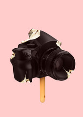A natural icecream. An alternative view of sweets. A camera formed creamy ice on the wooden stick...
