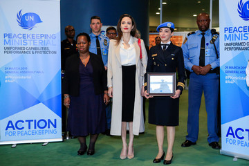 UNHCR Special Envoy Angelina Jolie poses for a picture next to Lieutenant Commander Braga, United Nations Military Gender Advocate of the Year and Assistant-Secretary General for Africa Keita, as she arrives to address a ministerial meeting on peacekeeping