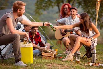 Girl add bottle of beer to boy