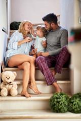 Female child with parents enjoying