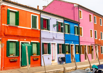Italy, Venice, Burano, view and architectural details of the typical colored houses.