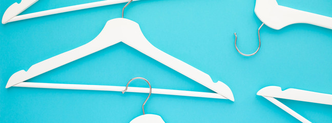 Wall Mural - White wooden hangers on blue background