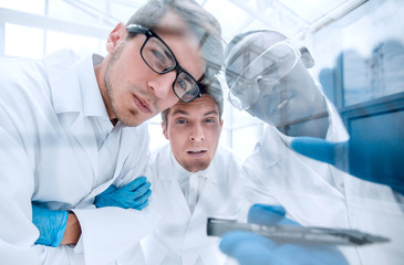 close up.a group of scientists discussing the results of the experimen