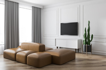 Modern living room design interior with sofa and TV screen.