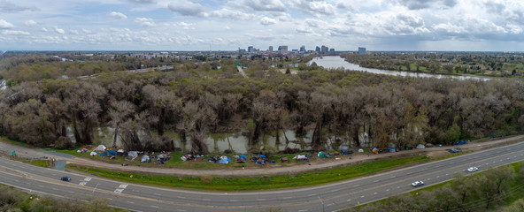 Aerial image of homeless tents along the rising river in Sacramento.