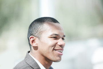 closeup.confident young businessman on background of office