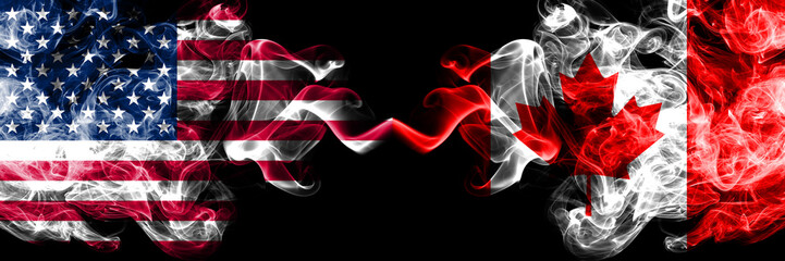 United States of America vs Canada, Canadian smoky mystic flags placed side by side. Thick colored silky smoke flags of America and Canada, Canadian