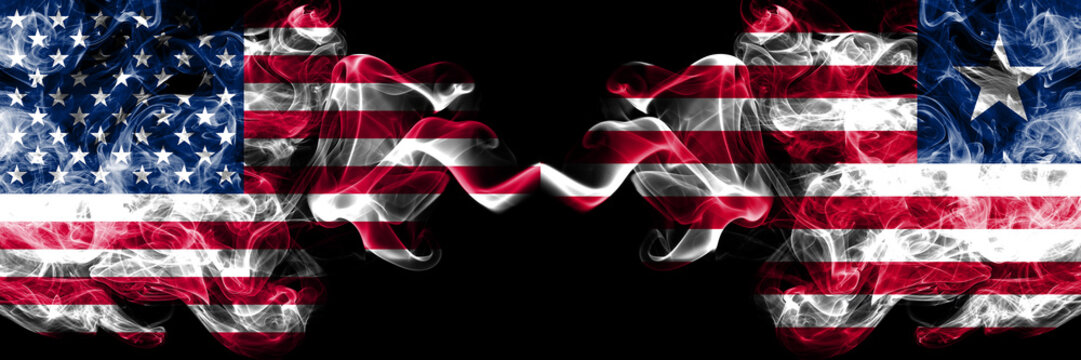 United States of America vs Liberia, Liberian smoky mystic flags placed side by side. Thick colored silky smoke flags of America and Liberia, Liberian