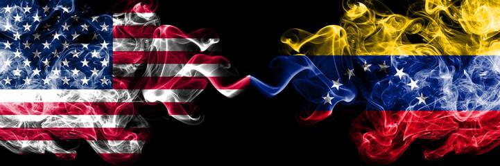 United States of America vs Venezuela, Venezuelan smoky mystic flags placed side by side. Thick colored silky smoke flags of America and Venezuela, Venezuelan