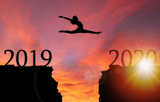 Sunrise Silhouette of Girl Leaping Over Cliff Toward New Year 2020