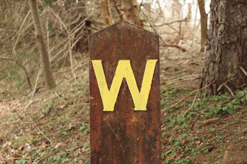 Rusted Letter W Signpost